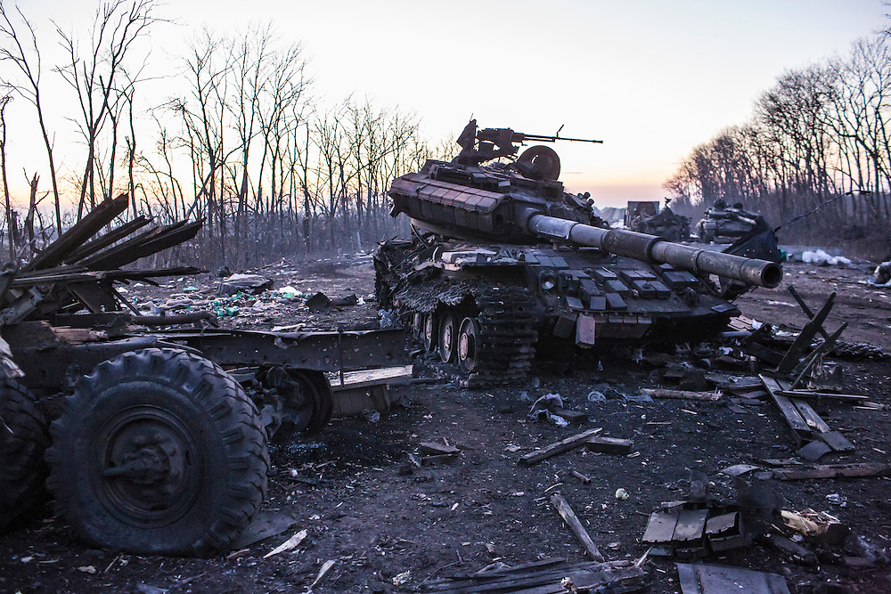 DEBALTSEVE, UKRAINE - FEBRUARY 20: Destroyed military equipment litters the road on February 20, 2015 in Debaltseve, Ukraine. Ukrainian forces withdrew from the strategic and hard-fought town after being effectively surrounded by pro-Russian rebels, though fighting has caused widespread destruction. (Photo by Brendan Hoffman/Getty Images) *** Local Caption ***