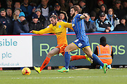 Jon Meades of AFC Wimbledon closes down Michael Harriman of Wycombe Wanderers during the Sky Bet League 2 match between AFC Wimbledon and Wycombe Wanderers at the Cherry Red Records Stadium, Kingston, England on 21 November 2015. Photo by Stuart Butcher.