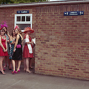 Ladies queue at the toilets at Royal Ascot Race Course. Royal Ascot is one of the most famous race meetings in the world, frequented by Royalty and punters from the high end of society to the normal everyday working class. Royal Ascot 2009, Ascot, UK, on Wednesday, June 17, 2009. Photo Tim Clayton..