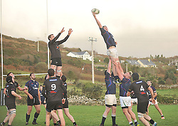 Westport's Eddie Dunning stretches to claim lineout ball during the junior league match in Clifden on sunday.<br /> Pic Conor McKeown