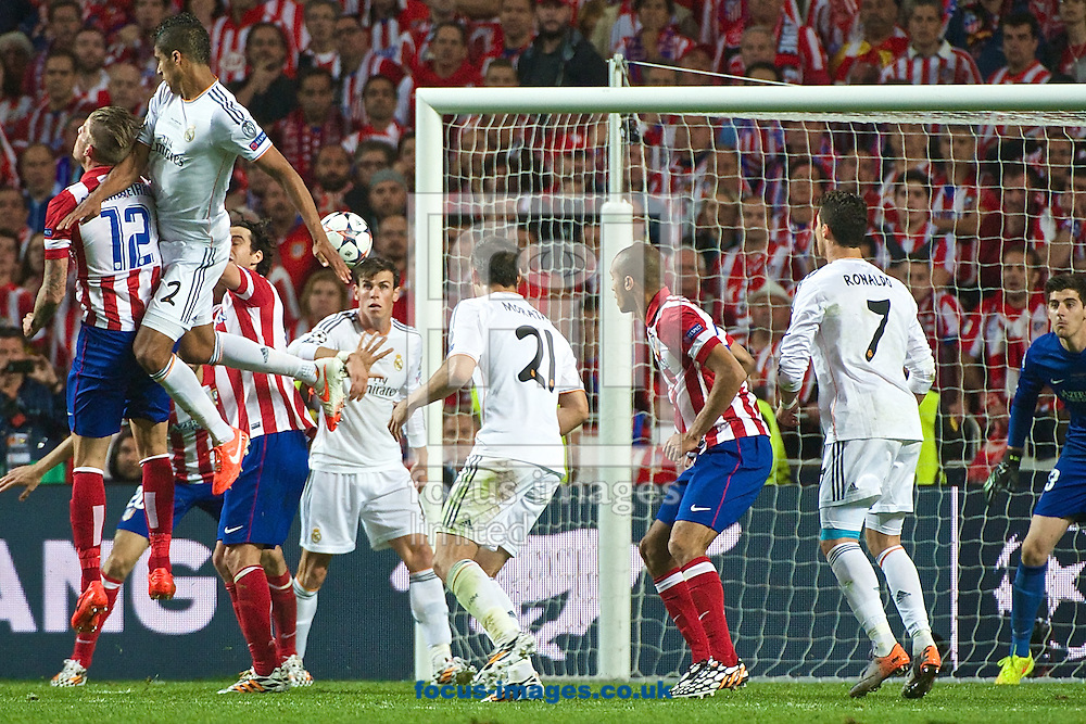 Rapha&euml;l Varane of Real Madrid heads at goal during the UEFA Champions League Final at Est&aacute;dio da Luz, Lisbon<br /> Picture by Ian Wadkins/Focus Images Ltd +44 7877 568959<br /> 24/05/2014