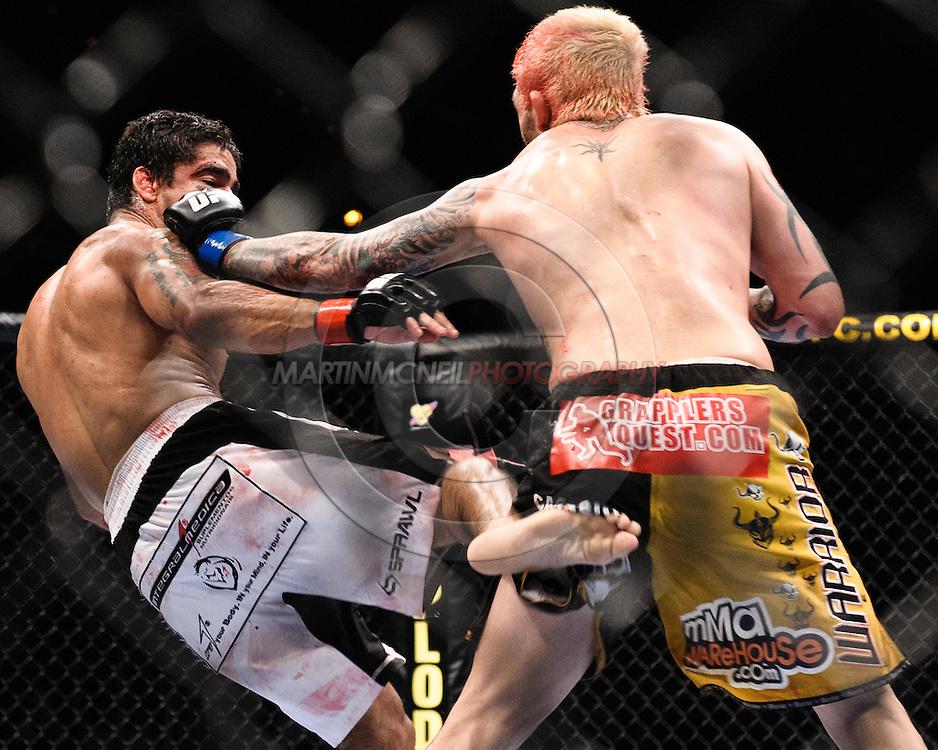 "ATLANTA, GEORGIA, SEPTEMBER 6, 2008: Thiago Tavares (left) and Kurt Pellegrino trade blows during ""UFC 88: Breakthrough"" inside Philips Arena in Atlanta, Georgia on September 6, 2008"