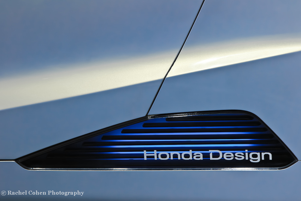 &quot;Honda Design&quot;<br /> <br /> Honda Design. A cool logo and blue light on the side of a Honda concept car at the 2013 NAIAS in Detroit!!<br /> <br /> Cars and their Details by Rachel Cohen