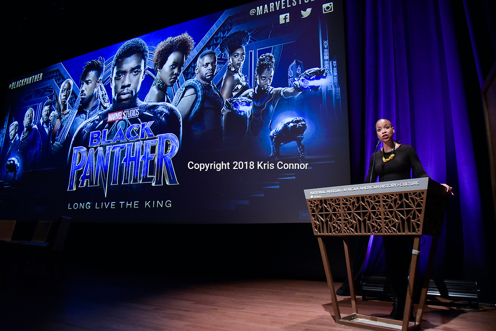 """Rhea Combs, PhD, Museum Curator of Photography and Film at The National Museum of African American History and Culture, before  director Ryan Coogler, costume designer Ruth Carter, and executive producer Nate Moore present a special advance screening of """"Black Panther"""" on Sunday, February 11 at the National Museum of African American History of Culture in Washington, D.C. (Photo by Kris Connor for Disney)"""