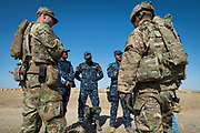 US Army soldiers provide support and assistance to Iraqi federal police during a sniper training course near West Mosul on May 16, 2017. The best candidates will be chosen from the course to join the fight against IS on the frontline in West Mosul in a few days time.