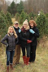 Komis family annual Christmas tree harvest, Friday, Nov. 25, 2016 at Meyer Tree Farm in New Albany.