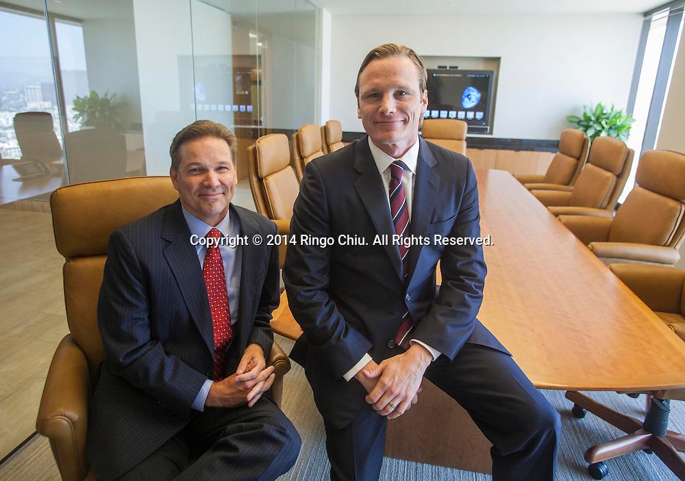 Geoffrey Stewart, right, and Sean Thorpe, portfolio managers of Aristotle Capital Management. (Photo by Ringo Chiu/PHOTOFORMULA.com)