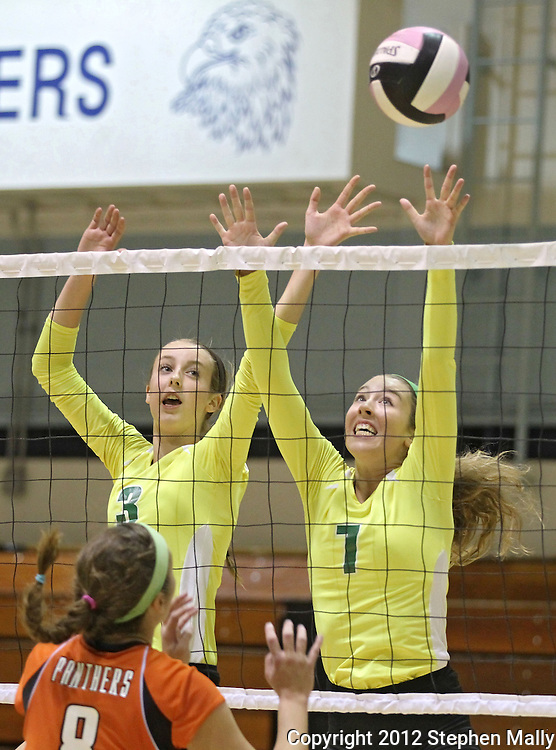 Kennedy's Jordan Calef and Erin Coker (from left) try to block the ball during their game against Tripoli at the Westside Volleyball Invitational at Jefferson High School in Cedar Rapids on Saturday October 6, 2012. Tripoli defeated Kennedy 25-19 and 25-21.