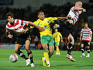 Doncaster - Tuesday September 14th, 2010:  \nc10 is beaten to the ball during the NPower Championship match at Keepmoat Stadium, Doncaster. (Pic by Dave Howarth/Focus Images)