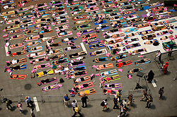 "New York, NY: Mon, Jun 21, 2010 : .Hundreds of yoga practitioners gather in Father Duffy Square for ""Solstice in Times Square: Mind over Madness."""