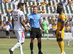 July 8, 2018 - Round Rock, USA - A game official talks with Pachuca's Robert Herrera (26) and Tigres' Enner Valencia (13) during a Liga MX friendly match between Tigres and Pachuca at Dell Diamond in Round Rock, Texas, on July 8, 2018. (Credit Image: © Scott W. Coleman via ZUMA Wire)