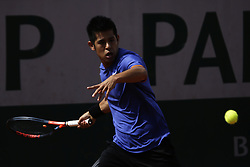 May 21, 2019 - Paris, France - Kiachi Uchida of JPN in action against Mizra Basic of BIH in the first round of Roland Garros qualifications in Paris, France, on 21 May 2019. (Credit Image: © Ibrahim Ezzat/NurPhoto via ZUMA Press)