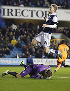 Colchester FC Goalkeeper Jamie Jones collects the ball before Millwall FC Midfielder George Saville can get a toe on it during the Sky Bet League 1 match between Millwall and Colchester United at The Den, London, England on 21 November 2015. Photo by Andy Walter.