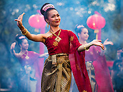 25 JANUARY 2017 - BANGKOK, THAILAND:        Thai traditional dancers perform during Chinese New Year, also called Tet, celebrations in Lumpini Park in Bangkok. 2017 is the Year of the Rooster in the Chinese zodiac. This year's Lunar New Year festivities in Bangkok were toned down because many people are still mourning the death Bhumibol Adulyadej, the Late King of Thailand, who died on Oct 13, 2016. PHOTO BY JACK KURTZ