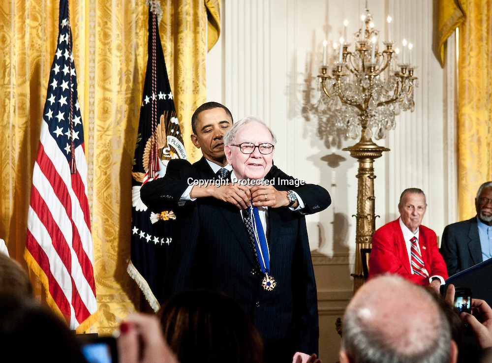 President Barack Obama awards the Medal of Freedom to  Warren Buffett during a ceremony in the East Room of the White House in Washington DC on February 15, 2011. Photo by Kris Connor