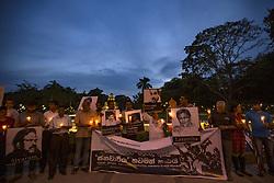 January 30, 2018 - Colombo, Sri Lanka - Wife of missing Sri Lankan cartoonist Prageeth Eknaligoda, Sandhya Eknaligoda and media activists engage in a silent protest by holding photos of slain journalists while holding  candles at the ''Black January'' vigil to commemorate  the disappeared,abducted and killed Sri Lankan journalists in Colombo, Sri Lanka January 30, 2018  (Credit Image: © Tharaka Basnayaka/NurPhoto via ZUMA Press)