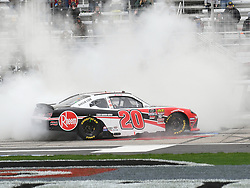 February 23, 2019 - Hampton, GA, U.S. - HAMPTON, GA - FEBRUARY 23: A victorious Christopher Bell, Joe Gibbs Racing, Toyota Supra Rheem (20) celebrates with a burnout after winning the Xfinity Series  Rinnai 250 on February 23, 2019, at Atlanta Motor Speedway in Hampton, GA.(Photo by Jeffrey Vest/Icon Sportswire) (Credit Image: © Jeffrey Vest/Icon SMI via ZUMA Press)