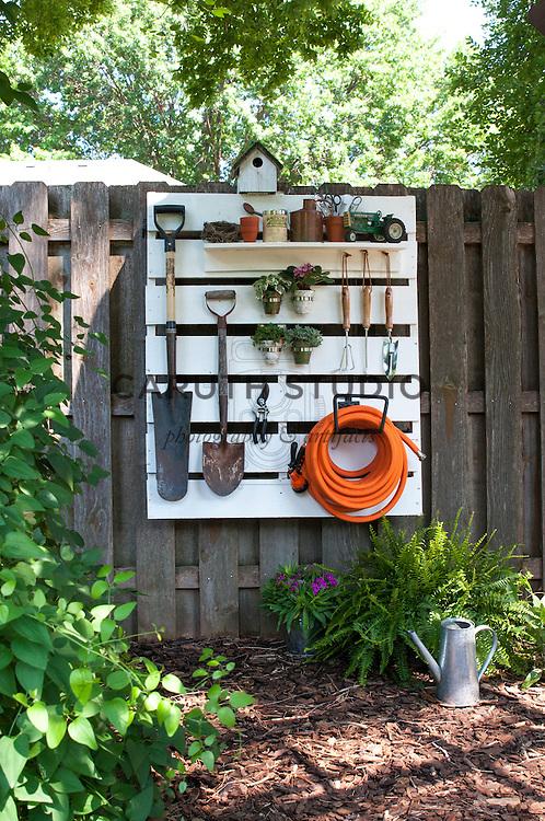 Shipping pallet garden tool storage