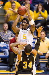 West Virginia Mountaineers forward Devin Williams (5) shoots a jump shot against the Wofford terriers during the first half at the WVU Coliseum.