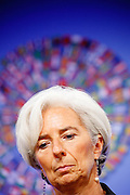 "he International Monetary Fund - IMF - holds its annual conference in DC amidst an US and European financial crisis. Newlye elected Managing Director Christine Lagarde has gotten a baptism by fire as she is handed the financial chaos in Europe. The ""glory"" behind her is the logo of the conference, consisting of the flags of all the IMF member countries."