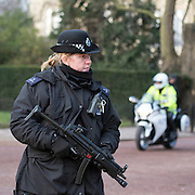 © Licensed to London News Pictures. 22/01/2015. London, UK. A female officer and a police motorcycle near the Mall near St James Palace.  Armed police officers in and around central London today 22 January 2015. UK Foreign Secretary Philip Hammond said that ISIS is the greatest threat to the UK's security at the moment. Photo credit : Stephen Simpson/LNP