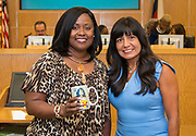 Houston ISD Trustee Diana Davila, right, recognizes Kelly Lavaughn Pichon during a Houston ISD Board of Trustee meeting, May 11, 2017.