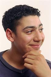Portrait of teenage boy smiling,