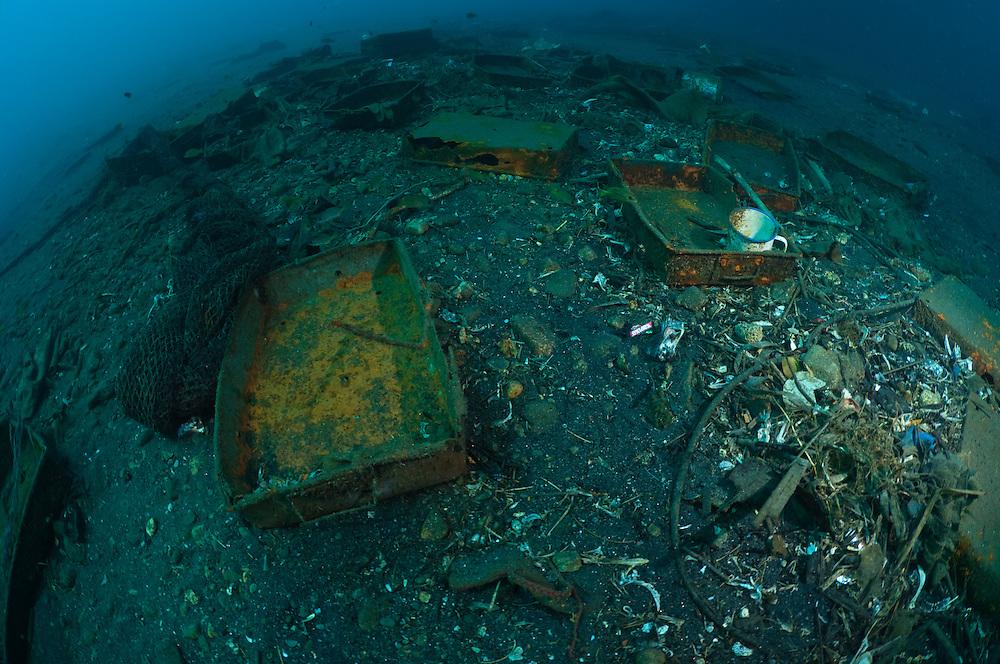 Rubbish and fishing equipment discarded beneath fishing boats, Indonesia.