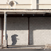 Human shadow on a wall, Albert Road, Woodstock, Cape Town, South Africa