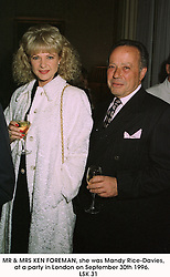 MR & MRS KEN FOREMAN, she was Mandy Rice-Davies, at a party in London on September 30th 1996.          LSK 31
