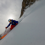 Andrew Whiteford skis storm powder in the Teton backcountry near Jackson Hole Mountain Resort. Teton Village, Wyoming.