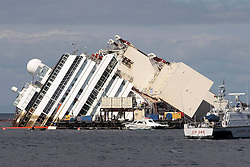 60482720 Isola del Giglio, Italy. Work begins today to right the stricken Costa Concordia vessel, which sank on January 12, 2012. If the operation is successful, it will then be towed away and scrapped. The procedure, known as parbuckling, has never been carried out on a vessel as large as Costa Concordia before, Italy, Monday September 16, 2013.<br /> Picture by imago / i-Images<br /> UK ONLY