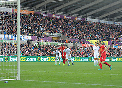 James Milner of Liverpool scores a penalty to make it 2-1 - Mandatory by-line: Alex James/JMP - 01/10/2016 - FOOTBALL - Liberty Stadium - Swansea, England - Swansea City v Liverpool - Premier League