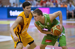 Vlado Ilievski of Macedonia vs Klemen Prepelic of Slovenia during friendly match between National teams of Slovenia and Republic of Macedonia for Eurobasket 2013 on July 28, 2013 in Litija, Slovenia. Slovenia defeated Macedonia 63-54. (Photo by Vid Ponikvar / Sportida.com)