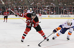 Mar 8; Newark, NJ, USA; New Jersey Devils left wing Ilya Kovalchuk (17) takes a shot while being defended by New York Islanders center Frans Nielsen (51) during the second period at the Prudential Center.