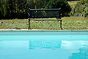 bench at swimming pool edge