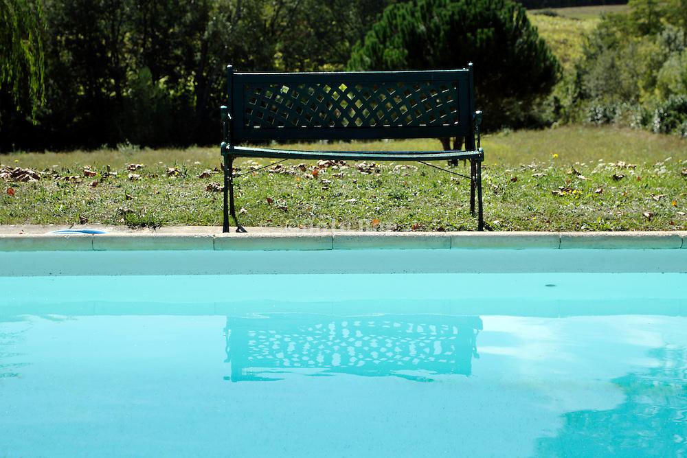 bench at swimming pool edge