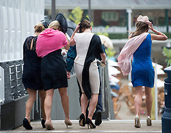 © London News Pictures. 22/06/2013. Ascot, UK.  Racegoers struggle through rain and strong winds on day 5 of Royal Ascot at Ascot racecourse in Berkshire, on June 20, 2013.  The 5 day showcase event,  which is one of the highlights of the racing calendar, has been held at the famous Berkshire course since 1711. Photo credit should read: Ben Cawthra/LNP
