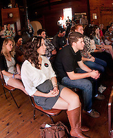Ivana Andreani and Anthony Carrese from St. Michael's College in NY listen to Republican Presidential candidate Jon Huntsman speak during his visit to the Merrimack Valley Railroad Company Monday afternoon.  (Karen Bobotas/for the Concord Monitor)