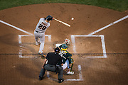 San Francisco Giants catcher Buster Posey (28) makes contact with a pitch against the Oakland Athletics at Oakland Coliseum in Oakland, California, on August 1, 2017. (Stan Olszewski/Special to S.F. Examiner)