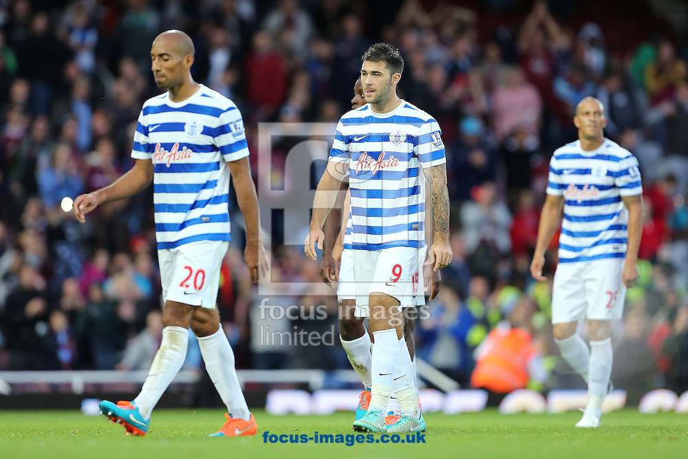 Queens Park Rangers players, (from left to right) Karl Henry, Charlie Austin and Bobby Zamora leave the pitch dejected after losing 2-0 to West Ham United during the Barclays Premier League match at the Boleyn Ground, London<br /> Picture by Richard Calver/Focus Images Ltd +447792 981244<br /> 05/10/2014