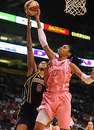 Aug 8, 2010; Phoenix, AZ, USA; Indiana Fever center Tammy Sutton-Brown puts up a basket against Phoenix Mercury forward Candice Dupree during the first half at US Airways Center.  Mandatory Credit: Jennifer Stewart-US PRESSWIRE