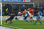 Gary Madine (30) of Blackpool is denied a goal by Tony Craig (5) of Bristol Rovers and Jamal Blackman (21) of Bristol Rovers during the EFL Sky Bet League 1 match between Bristol Rovers and Blackpool at the Memorial Stadium, Bristol, England on 15 February 2020.