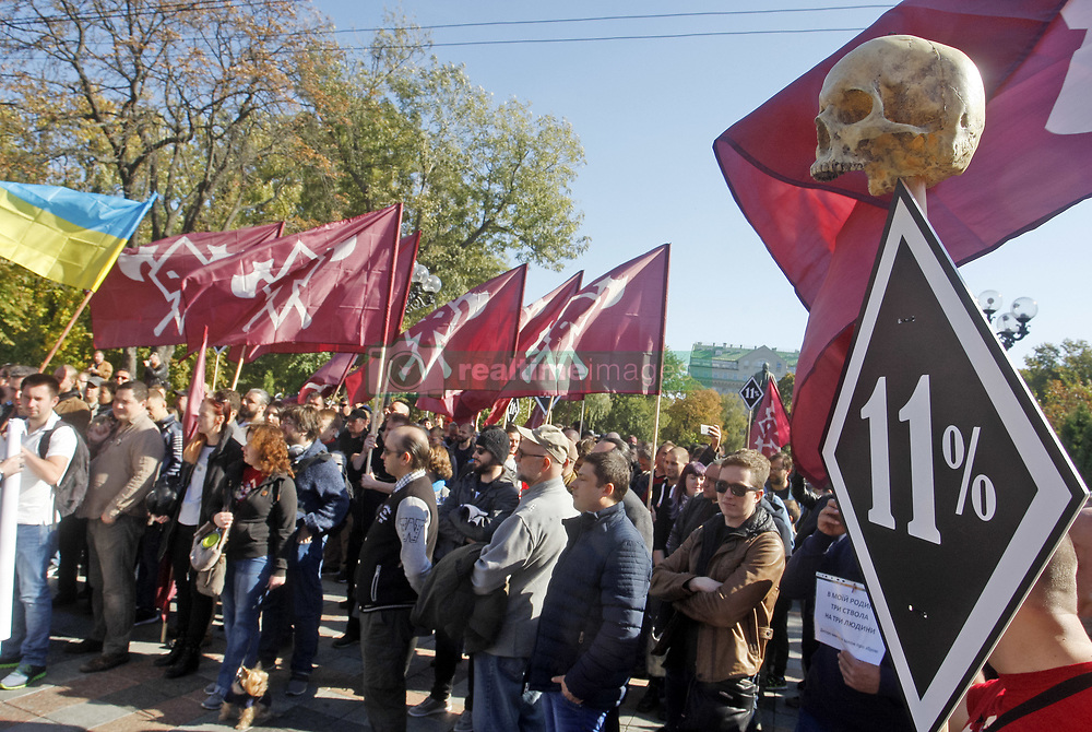 October 6, 2018 - Kiev, Ukraine - Activists from movement ''Democratic Ax'' seen attending their march for the right for weapons for self-defense in Kiev. The activists demand the adoption of a law for the right for weapons in self-defense and try to draw attention to the issue of the right to self-defense. (Credit Image: © Pavlo Gonchar/SOPA Images via ZUMA Wire)