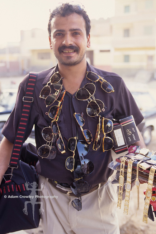 Sunglasses and watch salesman, Giza, Egypt.