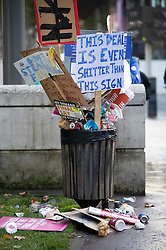 © Licensed to London News Pictures. 19/10/2019. London, UK. A rubbish bin is overflowing with food packaging and discarded placards after the People's Vote march took place in central London. The Prime Minister's new Brexit deal is being debated and voted on in an historic Saturday sitting in The House of commons today. Photo credit: Peter Macdiarmid/LNP