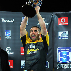 Dane Coles holds up the Super Rugby trophy after winning the Super Rugby final match between the Hurricanes and Lions at Westpac Stadium, Wellington, New Zealand on Saturday, 6 August 2016. Photo: Dave Lintott / lintottphoto.co.nz
