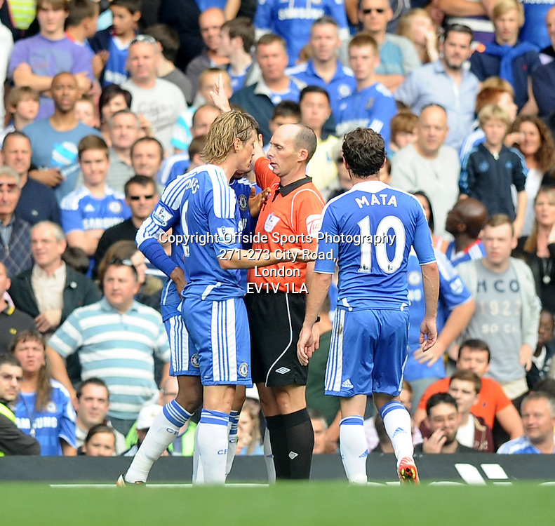 24/09/2011 - Barclays Premier League Football - Chelsea v Swansea City - Mike Dean sends Chelsea's Fernando Torres off for a late tackle . - Photo: Charlie Crowhurst / Offside.