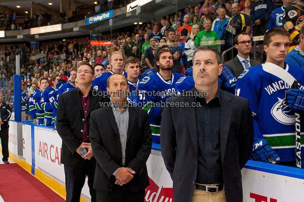 PENTICTON, CANADA - SEPTEMBER 16: Dean Clarke, Penticton Mayor Andrew Jakubeit, and former Vancouver Canucks' player, Stan Smyl stand at the bench during the national anthem against the Edmonton Oilers on September 16, 2016 at the South Okanagan Event Centre in Penticton, British Columbia, Canada.  (Photo by Marissa Baecker/Shoot the Breeze)  *** Local Caption *** Stan Smyl; Andrew Jakubeit; Dean Clarke;