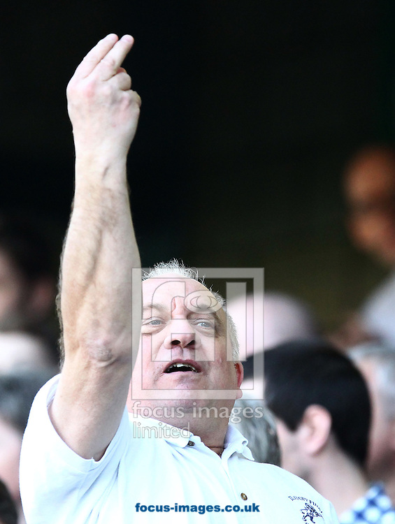 Picture by John Rainford/Focus Images Ltd. 07506 538356.24/03/12.A Millwall fan welcomes the travelling support of Leeds United to south-east London before kick-off in the Npower Championship match at The Den stadium, London.